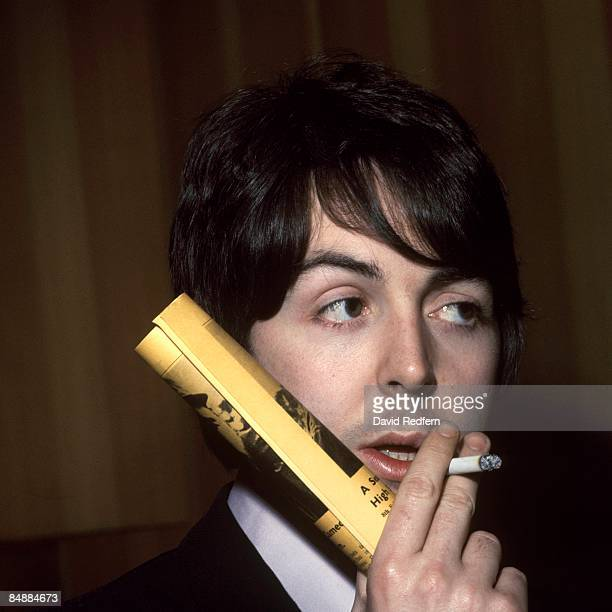 Photo of BEATLES and Paul McCARTNEY of The Beatles posed c1968/1969 smoking cigarette