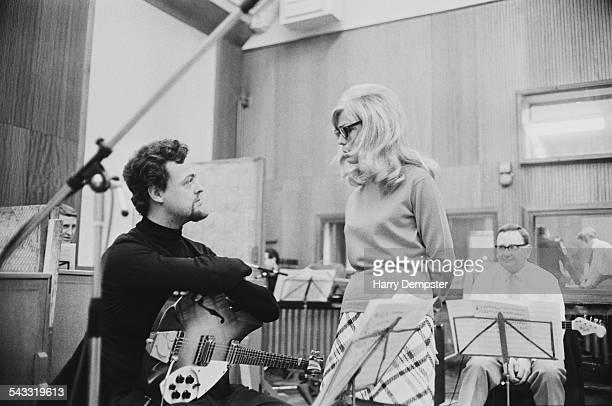 English musician Big Jim Sullivan and American singer and actress Nancy Sinatra in a recording studio 1967