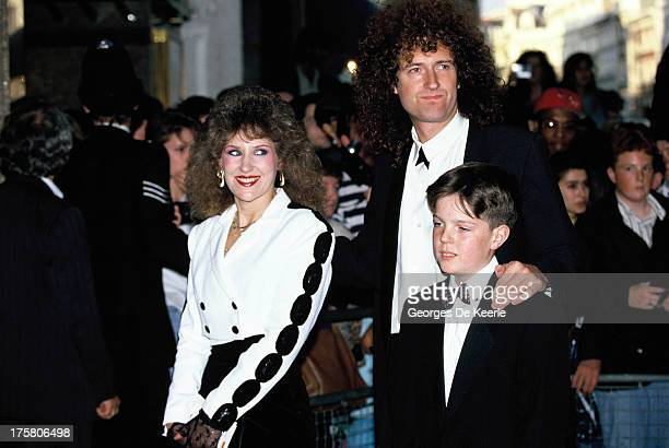 English musician Brian May of Queen with his wife Anita Dobson and his son Jimmy in 1990 ca in London England