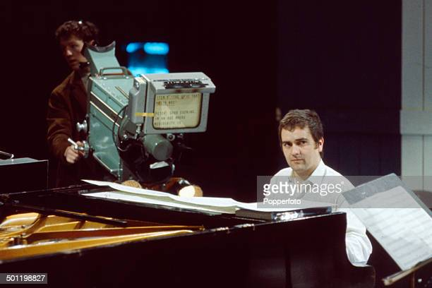 English musician comedian and actor Dudley Moore pictured sitting at a piano on the set of the television series 'Not OnlyBut Also' in 1966