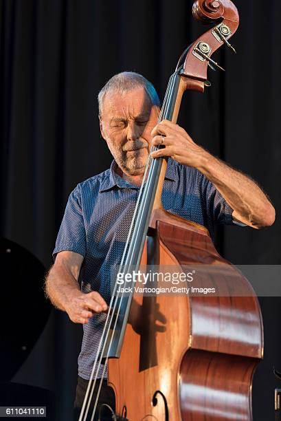 English musician Dave Holland plays upright acoustic bass at the 24th Annual Charlie Parker Jazz Festival in Tompkins Square Park, New York, New...