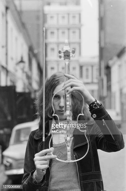 English musician Eddie Jobson of the progressive rock group Curved Air poses with his transparent electric violin, UK, 9th March 1973.
