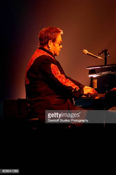 English musician Elton John plays piano as he performs onstage at the MaraLago Club Palm Beach Florida March 18 2006