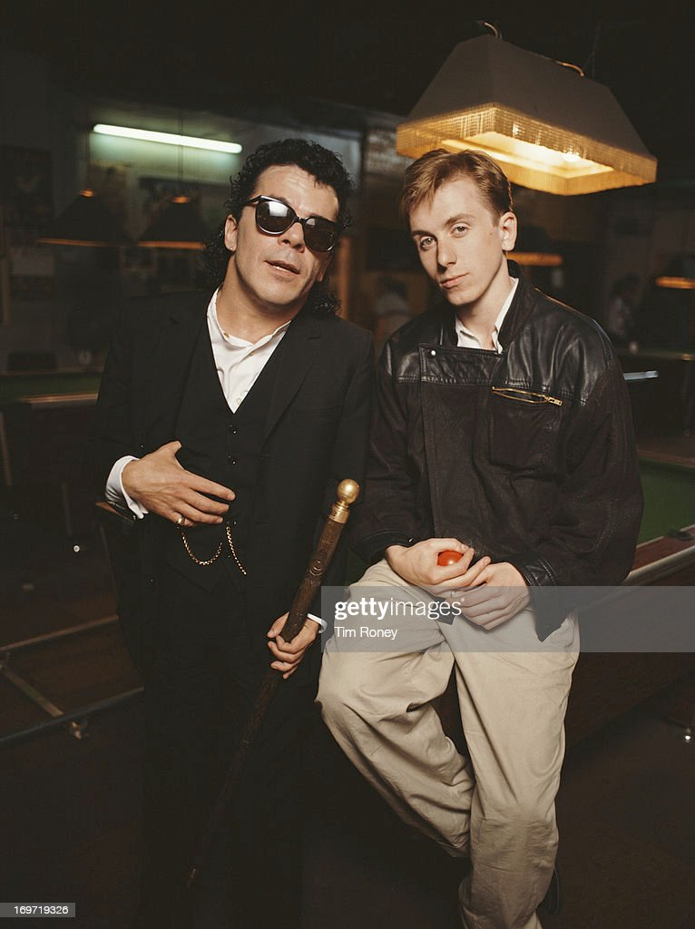 English musician Ian Dury with actor Tim Roth, circa 1986. The two appeared in the 1986 BBC television film 'King of The Ghetto'.