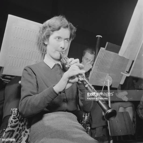 English musician Janet Craxton , an oboe player in the Hallé Orchestra, January 1952.