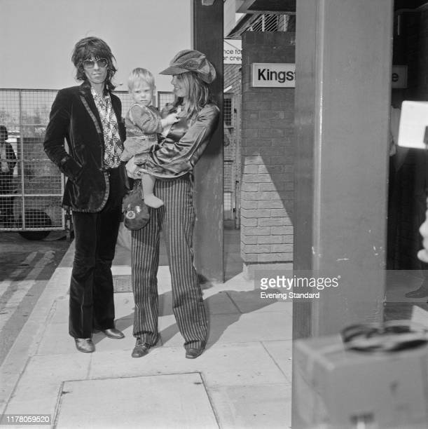 English musician Keith Richards of the Rolling Stones girlfriend Anita Pallenberg and their son Marlon arrive at London's Heathrow Airport for a...