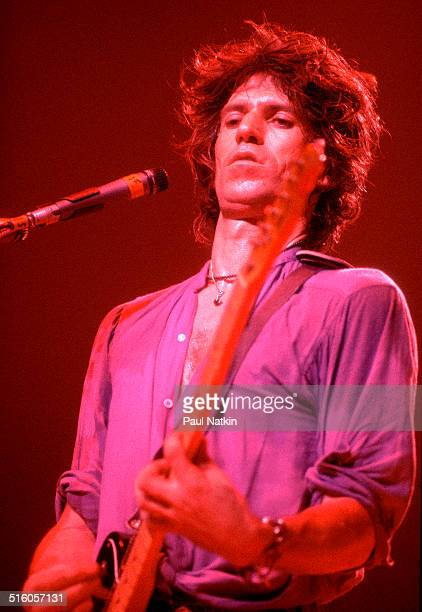 English musician Keith Richards plays guitar during a performance with his band the New Barbarians at the International Ampitheather Chicago Illinois...