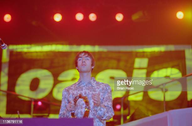 English musician Liam Gallagher, vocalist with Oasis, performs live on stage with the band at Earls Court Exhibition Centre in London in November...