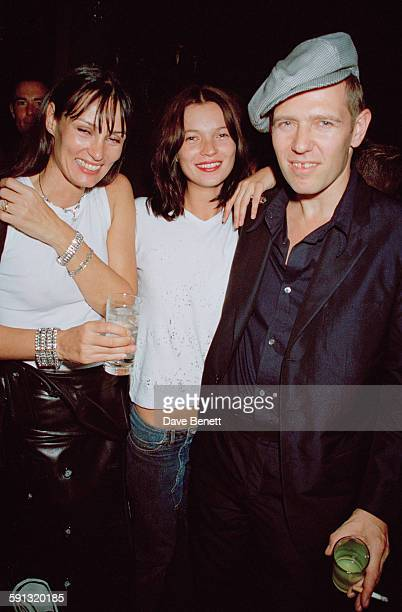 English musician Paul Simonon bassist for the punk rock band The Clash with his wife and manager Tricia Ronane and fashion model Kate Moss at a party...