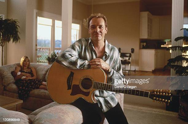 English musician Peter Frampton circa 1996 In the background are Frampton's third wife Tina Elfers and their baby daughter Mia Rose Frampton