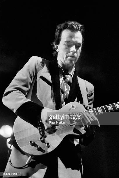 English musician Robbie McIntosh of the group Pretenders plays guitar as he performs at the Poplar Creek Music Theater in Hoffman Estates Illinois...