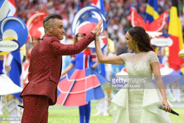 TOPSHOT English musician Robbie Williams and Russian soprano Aida Garifullina perform during the Russia World Cup opening ceremony before the...