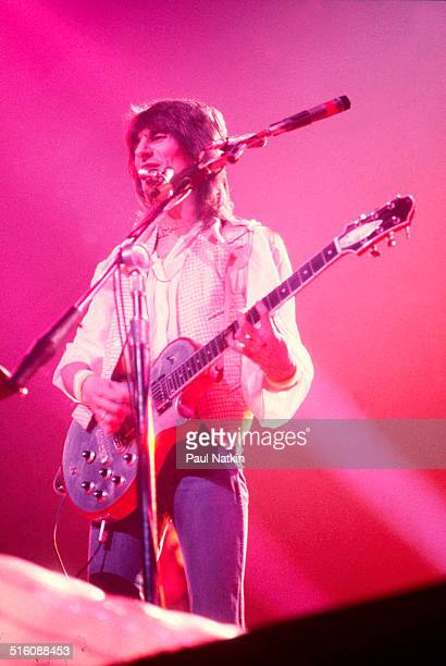 English musician Ron Wood plays guitar during a performance with his band the New Barbarians at the International Ampitheather Chicago Illinois April...