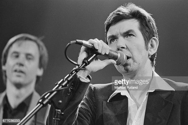 English musician Ronnie Lane performing on stage at a charity concert for ARMS held at the Royal Albert Hall London 20th September 1983 Lane a...