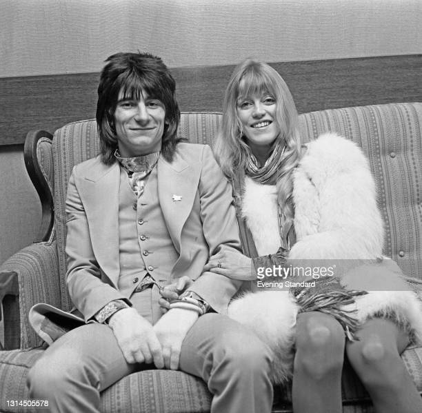 English musician Ronnie Wood of the rock band Faces at Heathrow Airport in London with his wife Krissy , UK, 24th January 1974. They are leaving for...