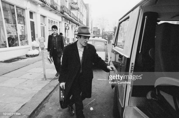 English musician singer actor and songwriter Joe Strummer of The Clash entering his tour bus to leave for a concert at De Montfort Hall Leicester...