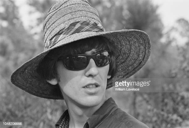 English musician singer and guitarist with the Beatles George Harrison pictured during production and filming of the British musical comedy film Help...