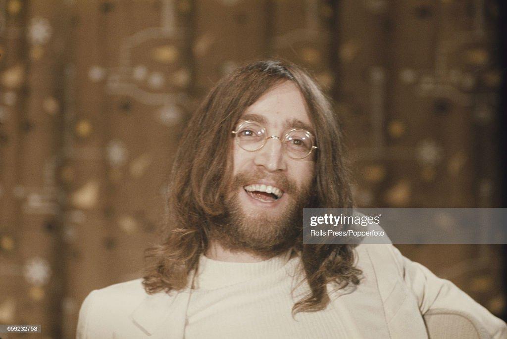John Lennon At Heathrow Airport : News Photo