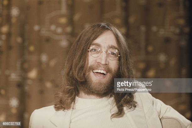 English musician singer and guitarist with the Beatles John Lennon pictured at a press conference at Heathrow airport in London on 1st April 1969