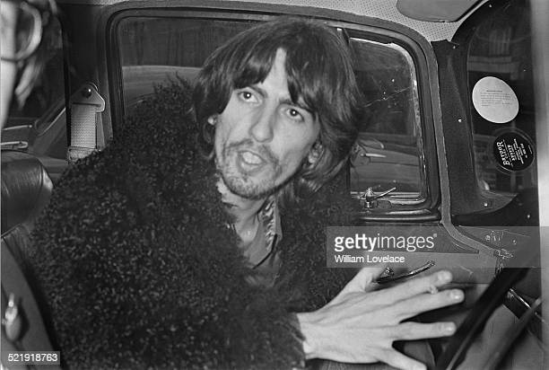 English musician, singer and songwriter George Harrison leaving a recording studio in Twickenham, London, 16th January 1969.