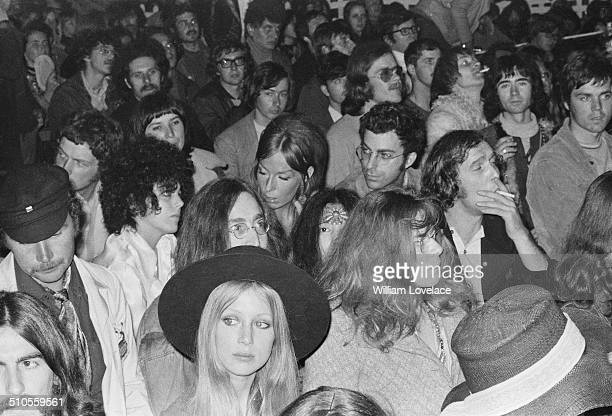 English musician singer and songwriter John Lennon and Japanese artist singer and peace activist Yoko Ono in the crowd during the Isle of Wight Music...