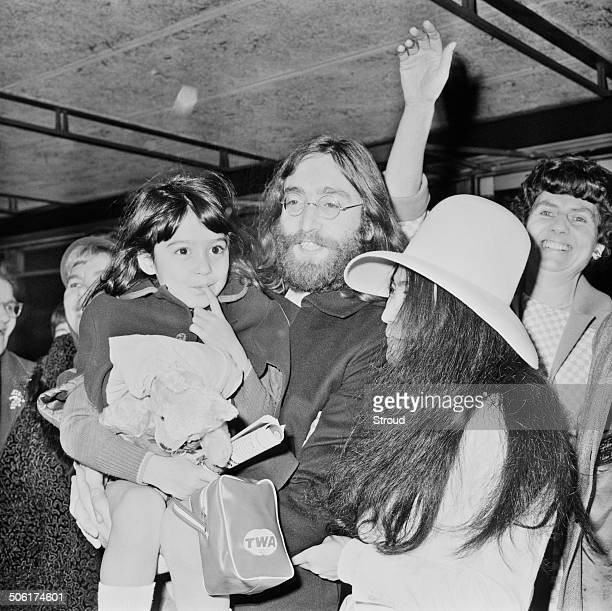 English musician singer and songwriter John Lennon and wife Japanese artist and singer Yoko Ono and her daughter Kyoko arrive at London Airport 18th...