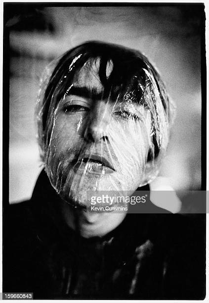 English musician singer and songwriter Liam Gallagher of rock band Oasis with a shower cap over his face in Newport Gwent Wales 5th May 1994