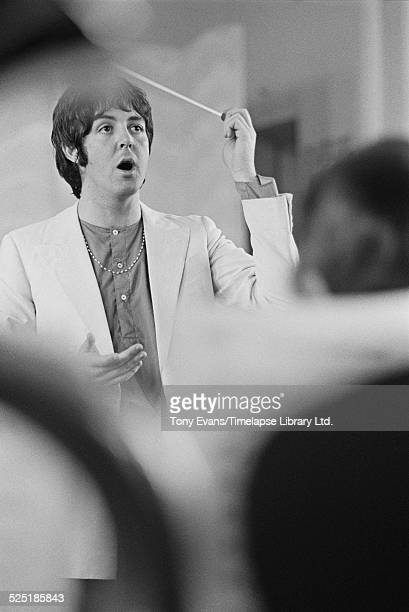 English musician singer songwriter and composer Paul McCartney records the LennonMcCartney composition 'Thingumybob' with the Black Dyke Mills Band...