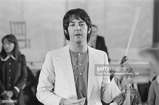 English musician, singer, songwriter, and composer Paul McCartney records the Lennon-McCartney composition 'Thingumybob' with the Black Dyke Mills...