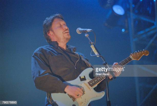English musician singer songwriter and guitarist Chris Rea performs live on stage at Wembley Arena in London on 26th January 1993