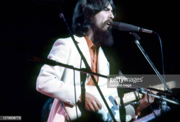English musician, singer, songwriter, music and film producer and lead guitarist for the Beatles, George Harrison performs at his Concert For...