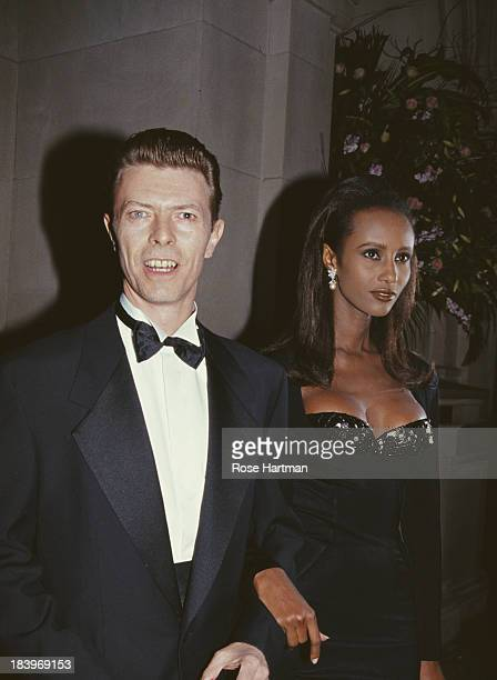 English musician singersongwriter and actor David Bowie with his wife Somali fashion model Iman circa 1995