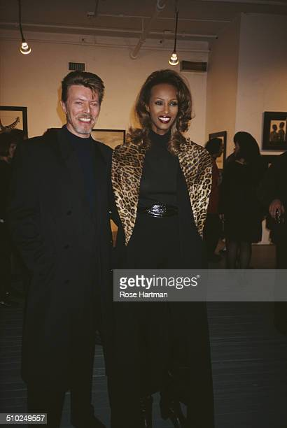 English musician singersongwriter and actor David Bowie with his wife Somali fashion model actress and entrepreneur Iman attend the 'Africa' opening...