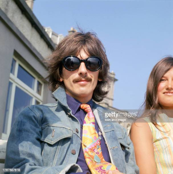English musician, singer-songwriter, and lead guitarist of the Beatles, George Harrison , during the filming of the television musical film 'Magical...