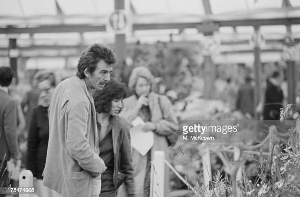 English musician, singer-songwriter, and music and film producer George Harrison attends the Chelsea Flower Show, London, UK, 21st May 1984.