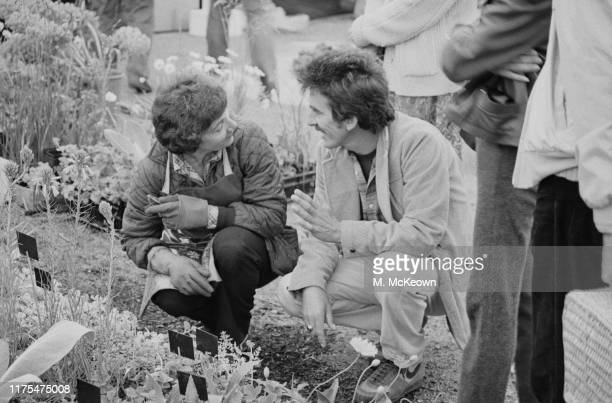 English musician, singer-songwriter, and music and film producer George Harrison talking to a gardener at the Chelsea Flower Show, London, UK, 21st...