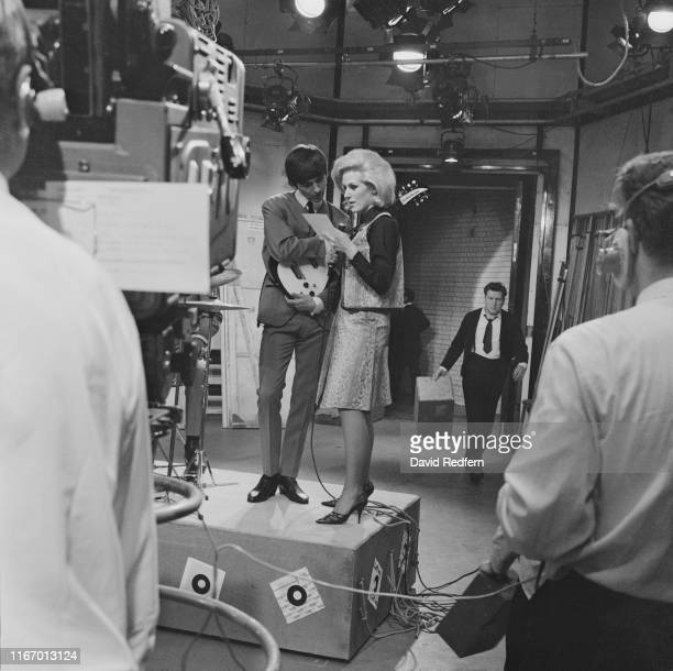 English musician singersongwriter George Harrison rehearsing with English singer Dusty Springfield on 'Ready Steady Go' at Television House Kingsway...