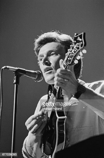 English musician Steve Winwood playing a mandolin on stage at a charity concert for ARMS held at the Royal Albert Hall London 20th September 1983