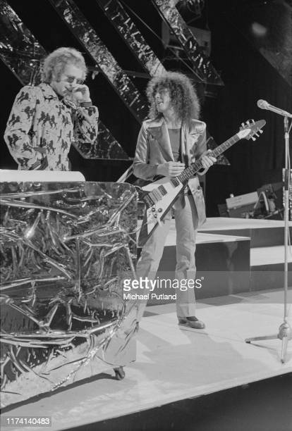 English musicians Elton John and Marc Bolan performing with glam rock group T Rex on the BBC TV music programme 'Top Of The Pops', London, December...