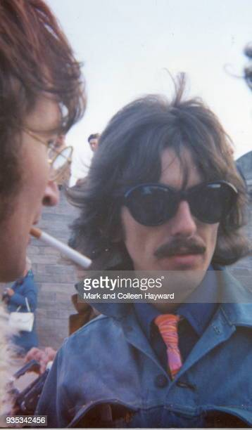 English musicians John Lennon and George Harrison of The Beatles during filming for surreal comedy television film 'Magical Mystery Tour' in Newquay...