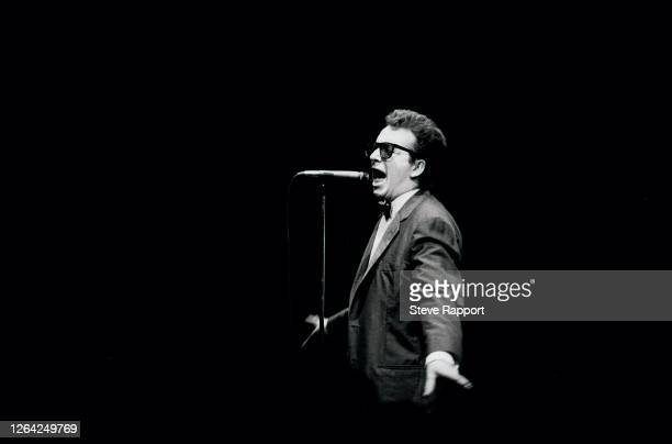 English New Wave & Pop musician Elvis Costello performs onstage, with the London Symphony Orchestra at the Royal Albert Hall, London, 1/7/1982.
