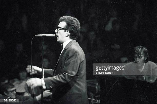 English New Wave & Pop musician Elvis Costello performs onstage, with the London Symphony Orchestra at the Royal Albert Hall, London, 1/7/1982. At...