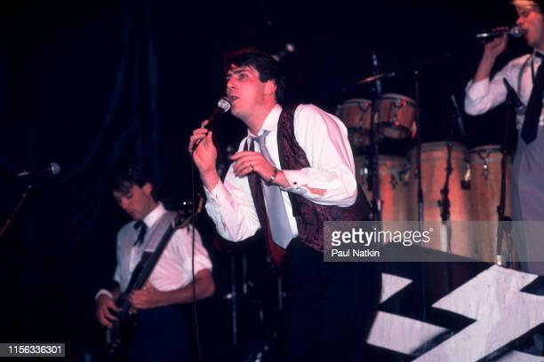 English New Wave singer Tony Hadley of the group Spandau Ballet performs onstage at the Shubert Theatre Chicago Illinois December 1 1983 Visible in...