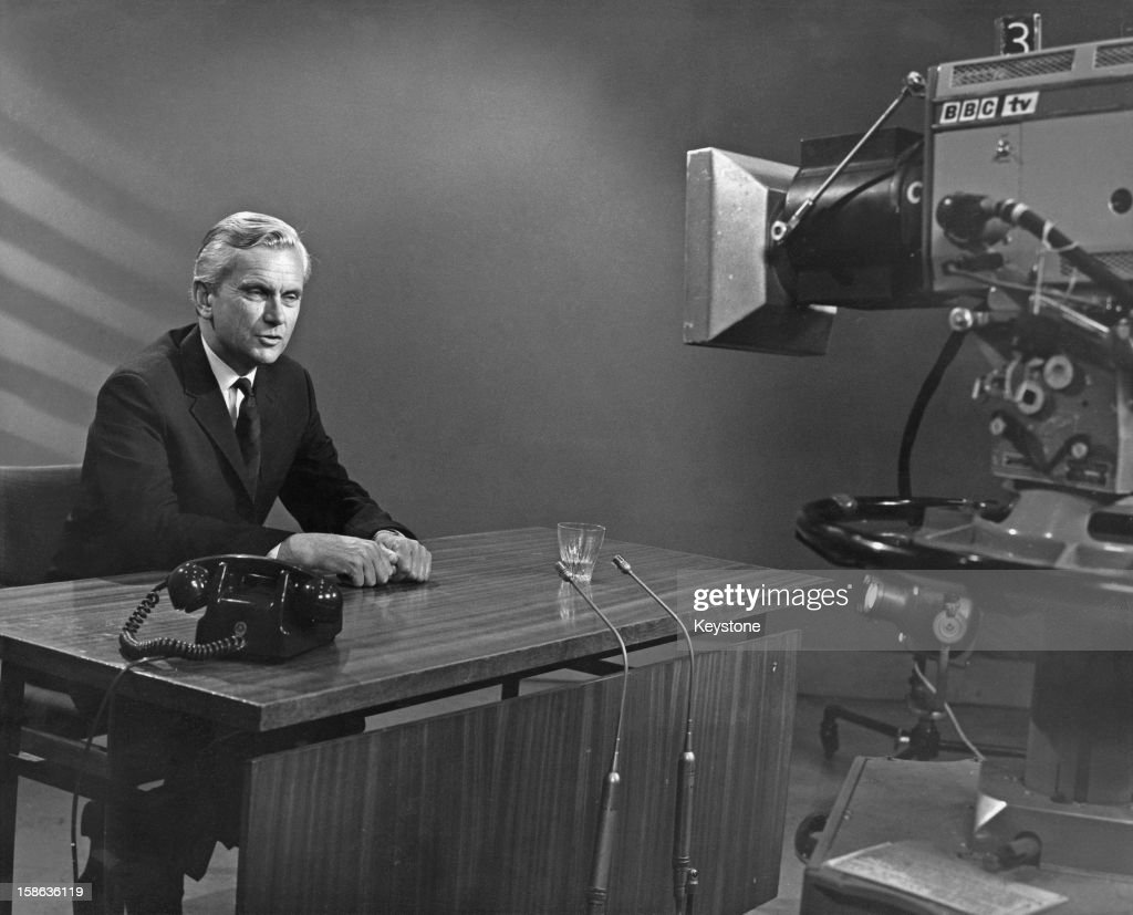 English newsreader Kenneth Kendall (1924 - 2012) in front of a camera at Broadcasting House, Portland Place, London, 30th June 1969. Kendall has just rejoined the BBC after eight years of freelance broadcasting work.