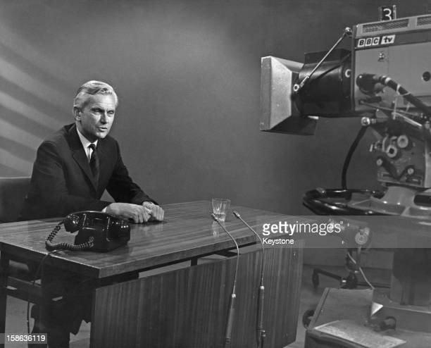 English newsreader Kenneth Kendall in front of a camera at Broadcasting House Portland Place London 30th June 1969 Kendall has just rejoined the BBC...