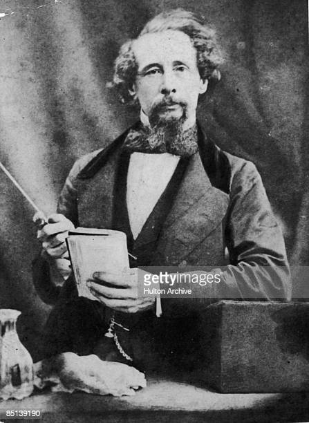 English novelist Charles Dickens gives a reading circa 1860