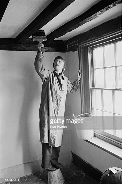 English novelist Emma Smith painting the ceiling of her cottage in StokebyNayland Suffolk England 29th April 1950 Original Publication Picture Post...