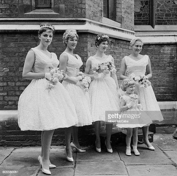 English novelist Jackie Collins as a bridesmaid at the wedding of actress Adrienne Scott and England rugby trialist and Wasps forward Gordon Benson...