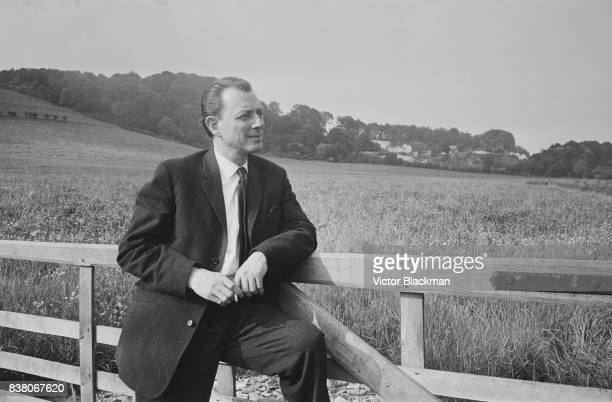 English osteopath and artist Stephen Ward who was one of the central figures in the 'Profumo affair' smokes a cigarette in the countryside 8th July...