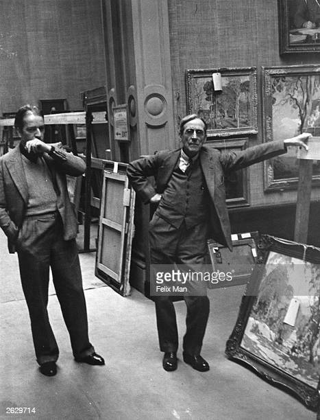 English painter Alfred Kingsley Lawrence RA with Sir Walter Russell Royal Academy Keeper of the Schools selecting pictures to be hanged in the...
